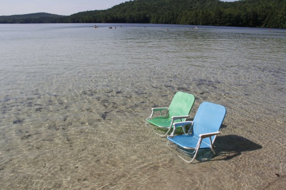 Chairs in the water at Long Pond