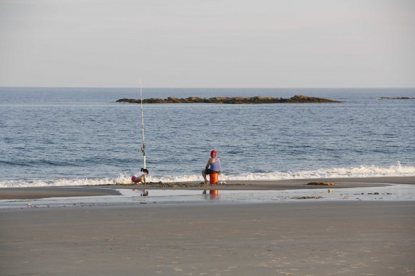 Summer evening fishing at the beach
