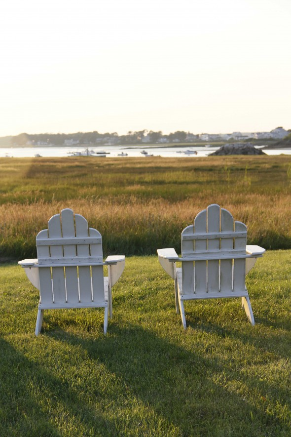 Two white adirondack chairs