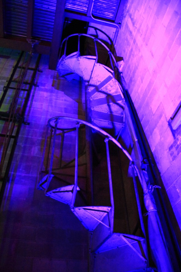 Illuminated three story spiral staircase