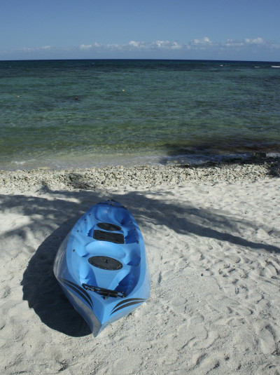 Blue kayak on Mexican beach