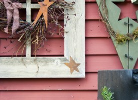 Rustic holiday decorations on red barn wall